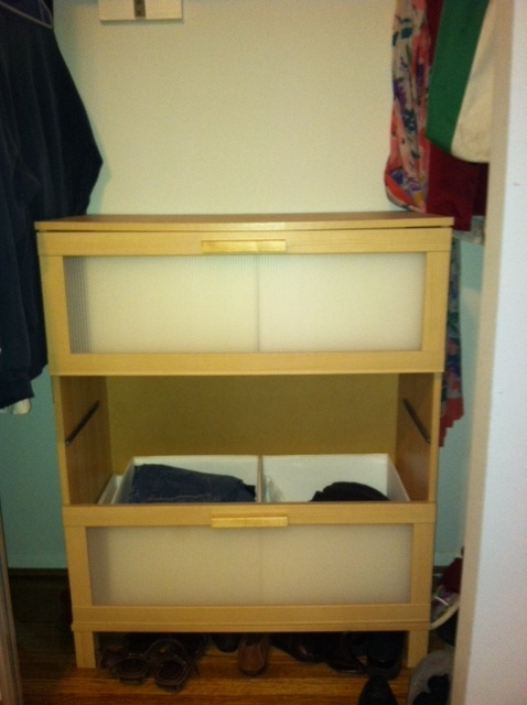 A dresser with middle drawer missing.