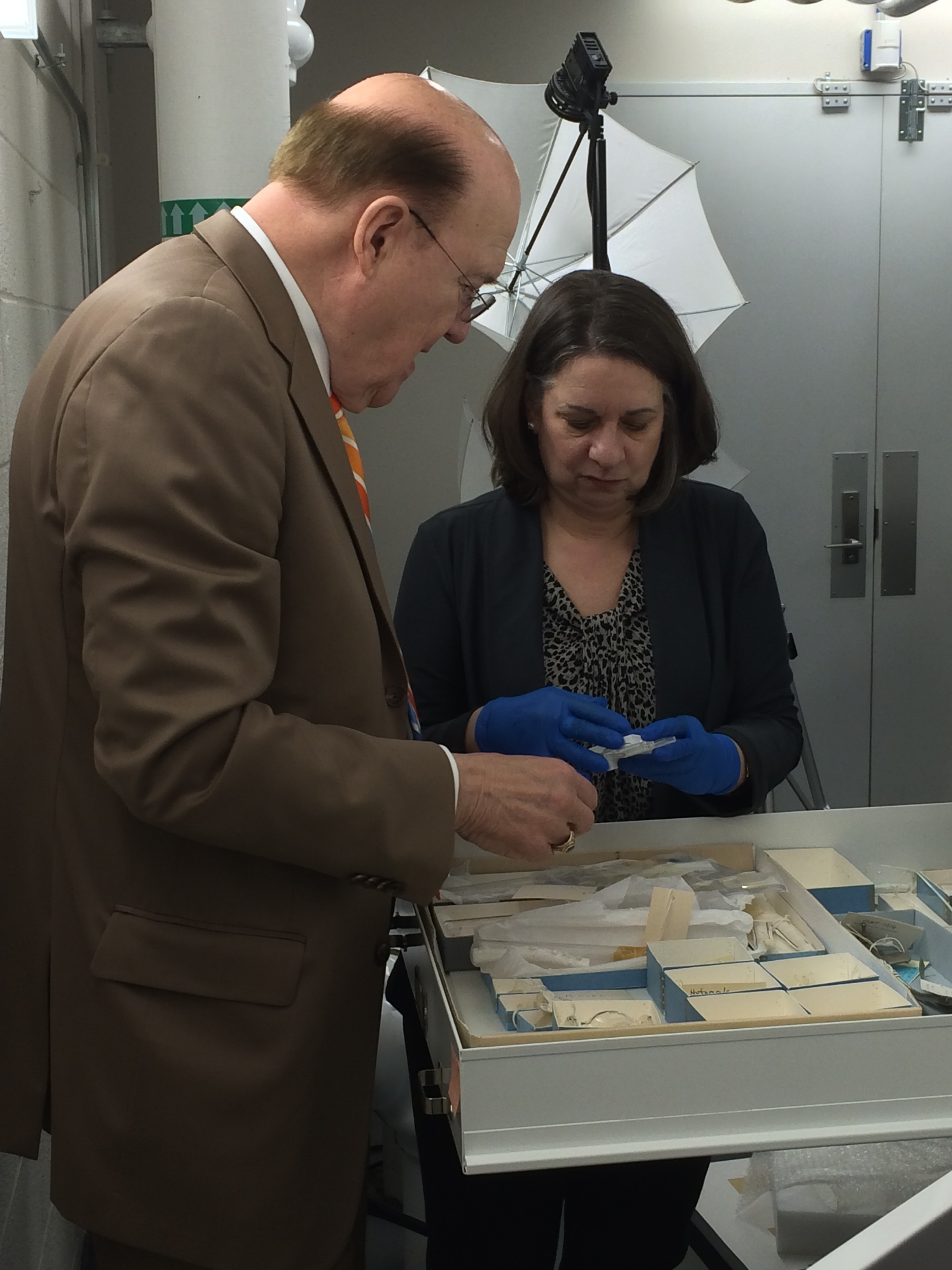 Manny Villafana with curator Judy Chelnick in storage viewing the cardiac collections.