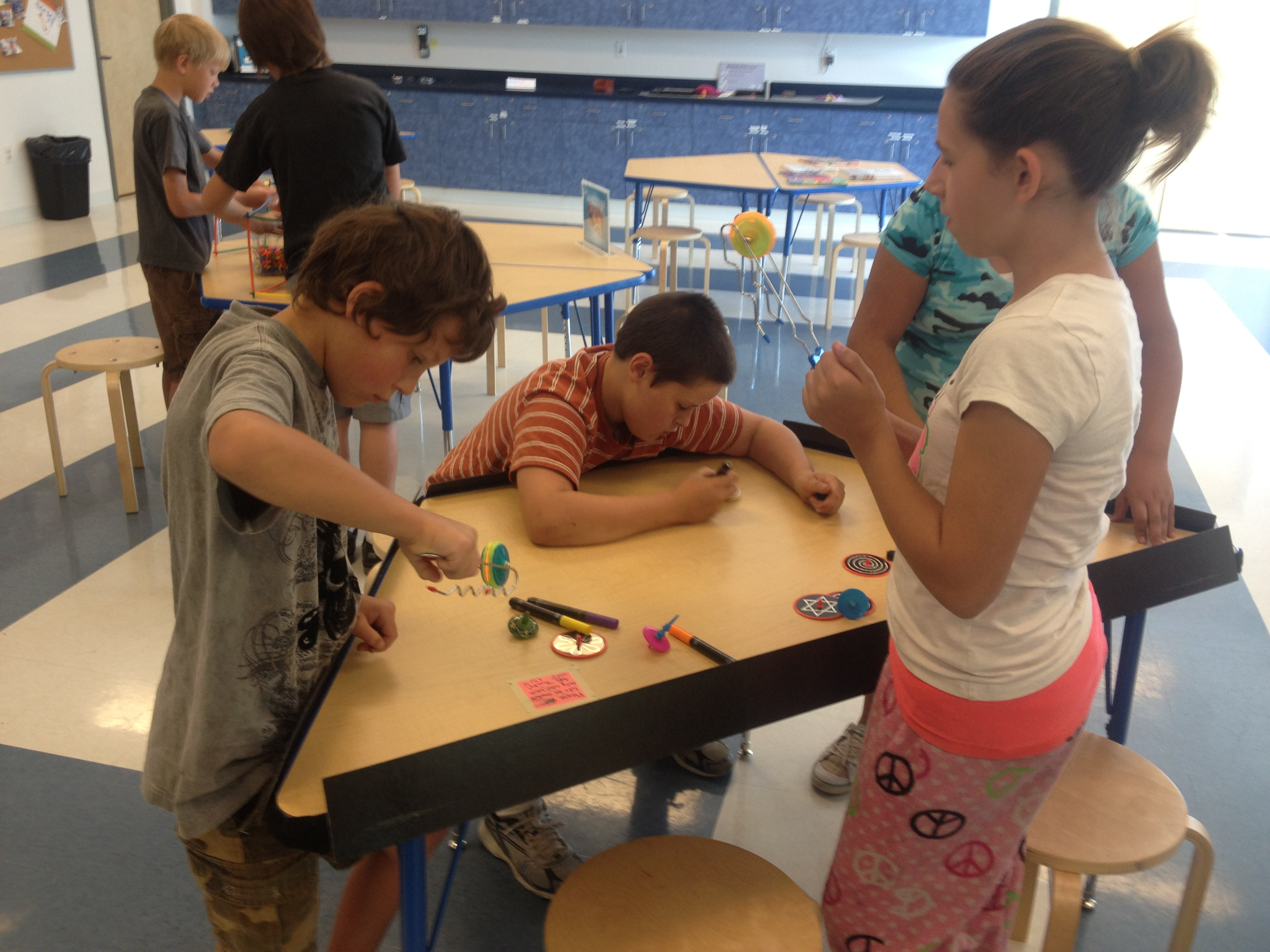 Children participating in hands-on invention activities.