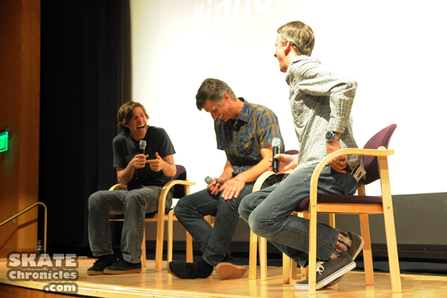 """Rodney Mullen, Miki Vuckovich, and Tony Hawk share a laugh on stage following a screening of """"Bones Brigade: An Autobiography."""""""