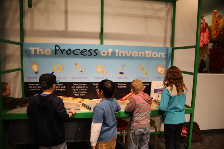 Young visitors to Spark!Lab learn about the invention process as they work through their ideas from start to finish