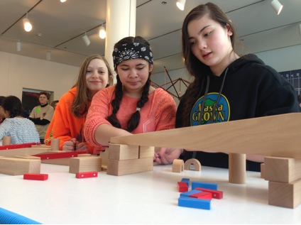 Visitors practice collaboration end engineering skills in Spark!Lab at the Anchorage Museum.