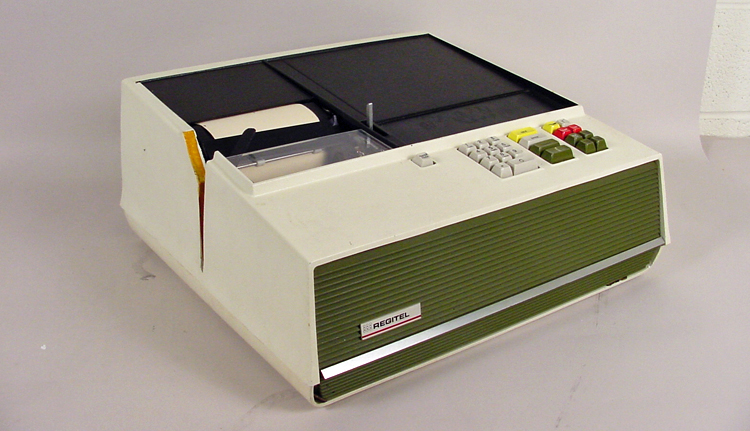 Rectangular black-and-beige plastic box with keypad on right and register tape on left.