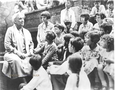 Jane Addams with children at Hull House, photograph by Allen, Gordon, Schroeppel and Redlich, Inc., 1933.