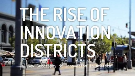 """Cover of the report """"The Rise of Innovation Districts"""": text over blurry urban streetscape."""