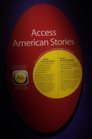 Sign announcing accessibility app in English and Spanish in American Stories