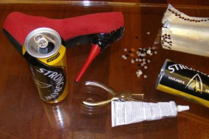 Strongbow kit: cans, vintage shoe, hole punch, glue.