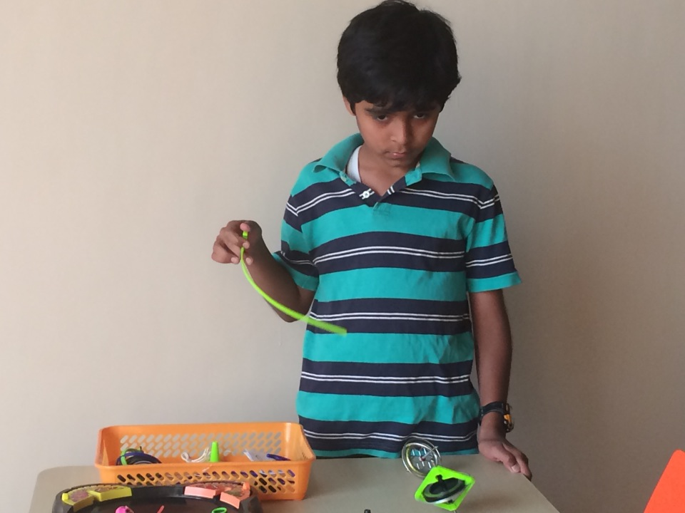 A young boy experiments with gyroscopes.