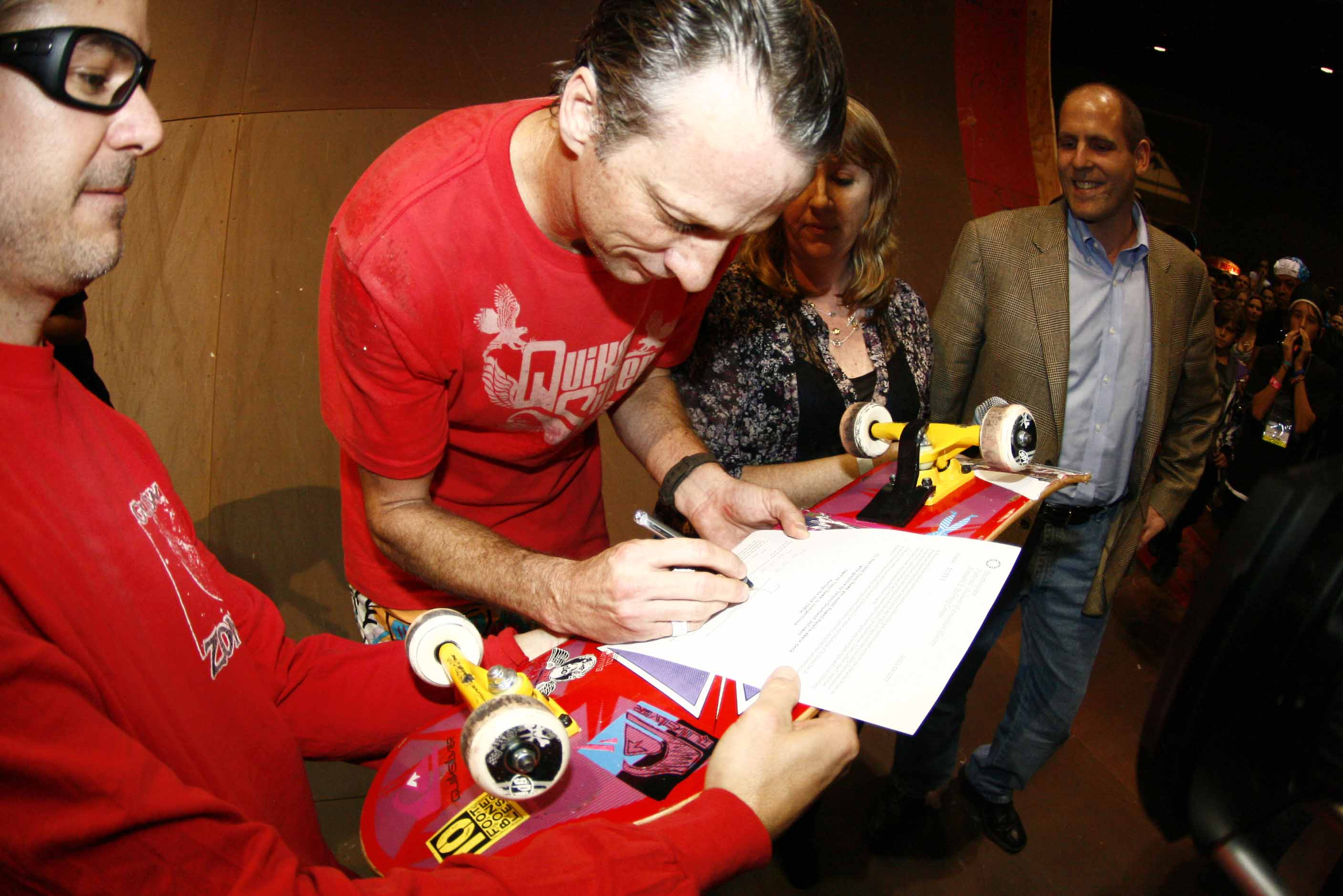 Tony Hawk signs deed of gift while on skate ramp