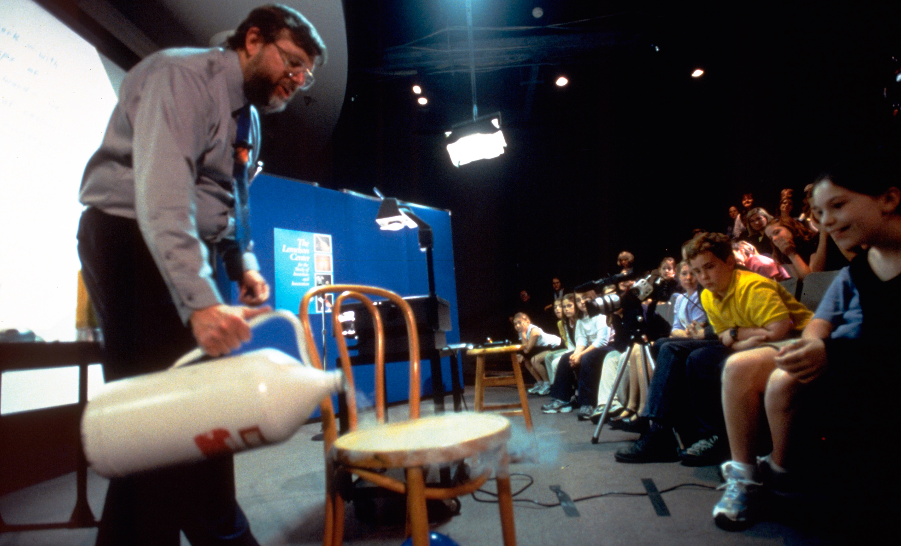 Image of William Phillips demonstrating Liquid Nitrogen