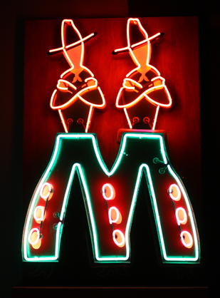 Neon sign depicting cowboys